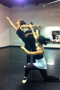 Dancers show off one of their latest moves before practice begins.