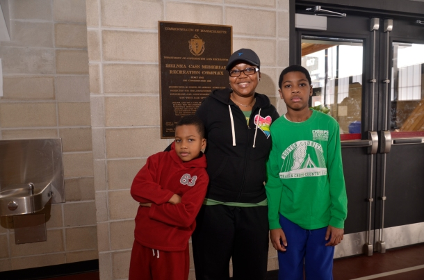 Tammi King of Dorchester stands with sons Jhalen,7, and Jovan, 11 who have been enrolled in the Boston Track and Cross Country Club since it's 2011 opening.