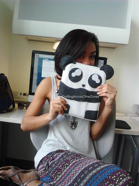 Here, Maria poses with an iPad case she made.
