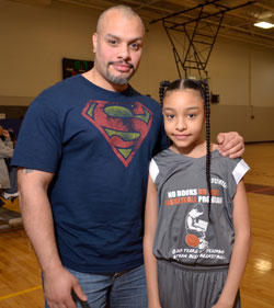First year player Daniellis Flores, 9, stands proudly with dad Danny Flores, 34, of Roxbury after playing successfully. Her older sister's game would be starting shortly after.