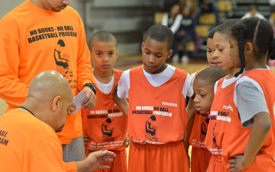 """No Books No Ball"" founder and executive director Tony Richards gives strategy and direction to his players during a quick time-out at the John A. Shelburne Community Center in Roxbury, MA."