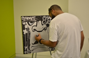 Towards the end of the evening artist Mike Lee, who graduated from graffiti art to graphic design, creates a piece of artwork before a small audience at the Juneteenth Takeover pop-up shop exhibition at the Museum of Fine Arts.