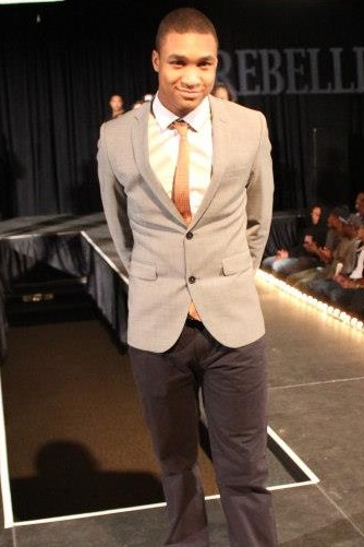 A proud King poses after his clothing line appeared in Bentley University's 2013 Fashion Show.
