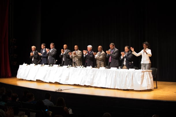 The 2013 mayoral candidates offer a thunderous applause following the end of the forum. Candidates discussed the state of Boston Public Schools and high school dropouts.